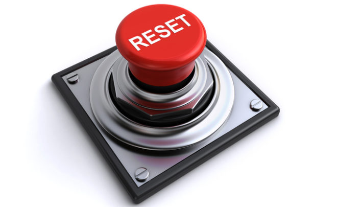 red reset button on the white background (3d render)